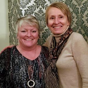 image of long-term employees celebration Cathy Rathburn with Lori Kress